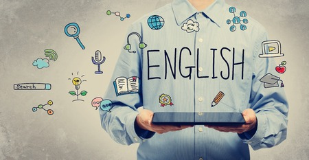 language learning: English concept with young man holding a tablet computer