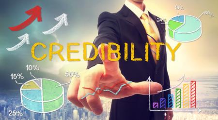 Credibility Konzept mit Geschäftsmann und Grafiken und Pfeile Standard-Bild - 54662719