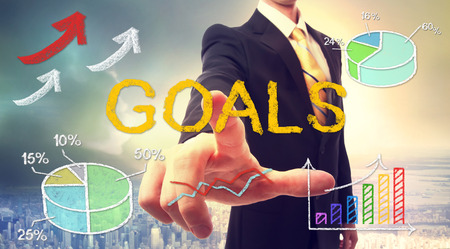 goal achievement: Goals concept with businessman and graphs and arrows Stock Photo