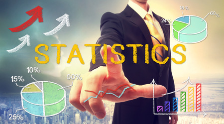Statistics concept with businessman and graphs and arrows