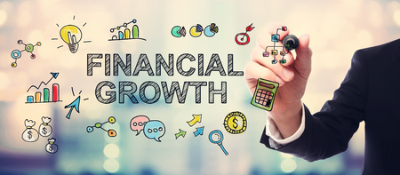 shiny suit: Businessman drawing Financial Growth concept on blurred abstract background