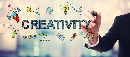 creativity concept: Businessman drawing Creativity concept on blurred abstract background Stock Photo