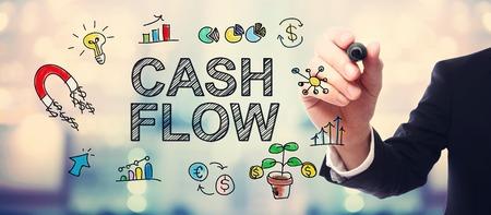 ingresos: de plano el concepto de flujo de efectivo en fondo borrosa abstracta del hombre de negocios