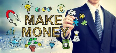 Businessman drawing Make Money concept above the city 版權商用圖片