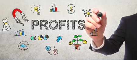 Businessman drawing Profits concept with a marker Archivio Fotografico