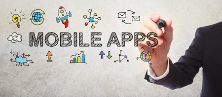 Businessman drawing Mobile Apps concept with a marker Stockfoto