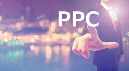 PPC concept with businessman on blurred city background Stock Photo