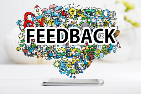 feedback: Feedback concept with smartphone on white table Stock Photo