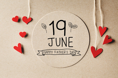 small paper: 19 June Happy Fathers Day message with handmade small paper hearts Stock Photo