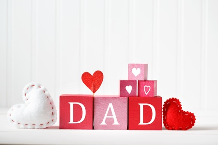 Fathers Day message on red and pink wooden blocks