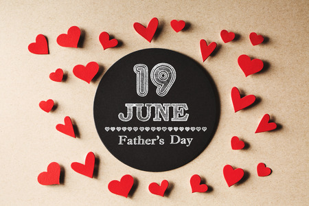 small paper: 19 June Fathers Day message with handmade small paper hearts Stock Photo