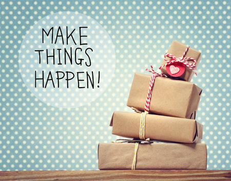 make a gift: Make Things Happen message with stack of gift boxes Stock Photo