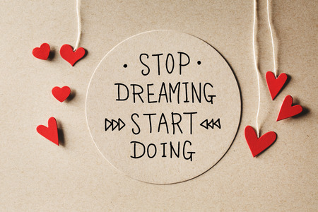 Stop Dreaming Start Doing message with handmade small paper hearts 스톡 콘텐츠
