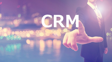 relation: CRM concept with businessman on blurred city background Stock Photo