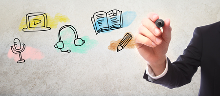 pen and marker: Businessman drawing E-Learning concept with a marker