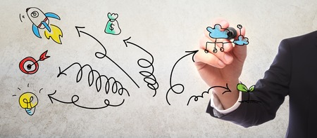 Businessman drawing arrows and business concepts cartoon with a marker