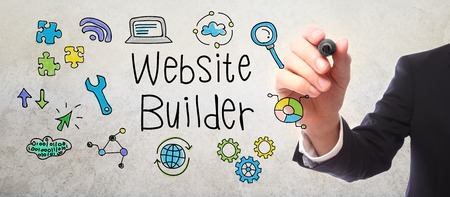 creation of sites: Businessman drawing Website Builder concept with a marker