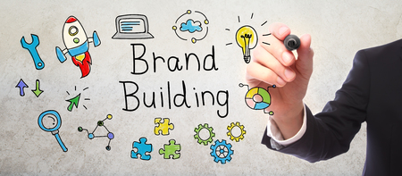 brands: Businessman drawing Brand Building concept with a marker