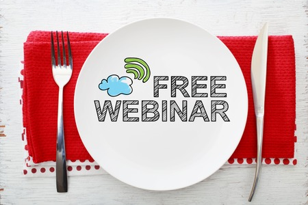 napkins: Free Webinar concept on white plate with fork and knife on red napkins
