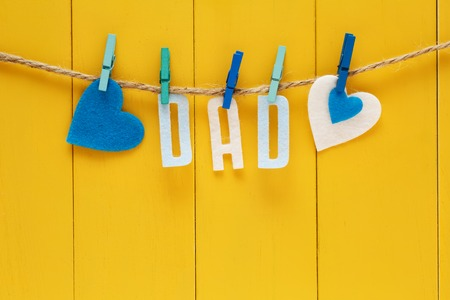 Fathers Day theme with hanging felt DAD letters Stok Fotoğraf