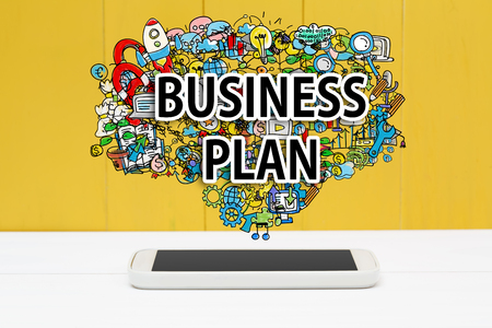 smartphone business: Business Plan concept with smartphone on yellow wooden background Stock Photo