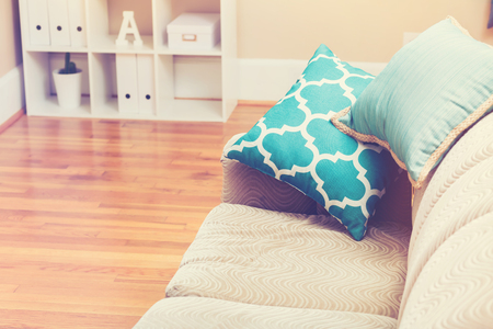 room: Bright living room interior with turquoise sofa pillows