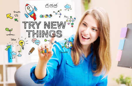 try: Try New Things concept with young woman in her home office Stock Photo