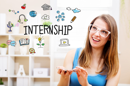 Internship concept with young woman wearing white glasses using her smartphone in her home