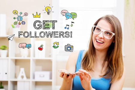 woman smartphone: Get followers concept with young woman wearing white glasses using her smartphone in her home