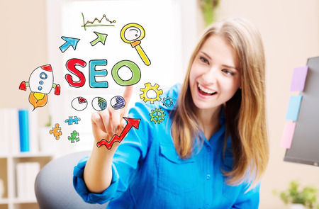 blue shirt: SEO concept with young woman in her home office