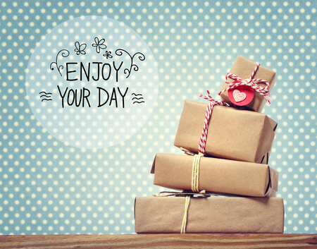 boite carton: Enjoy Your Day message with stack of gift boxes