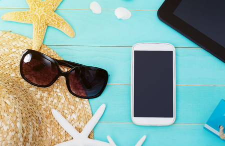 straws: High Angle View of Mobile Gadgets with Starfish, Sea Shells and Beach Hat Stock Photo