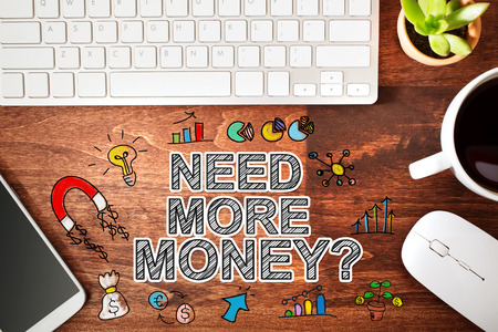 more money: Need More Money concept with workstation on a wooden desk
