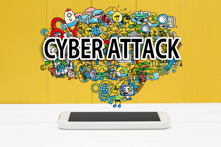 cyber attack: Cyber Attack concept with smartphone on yellow wooden background