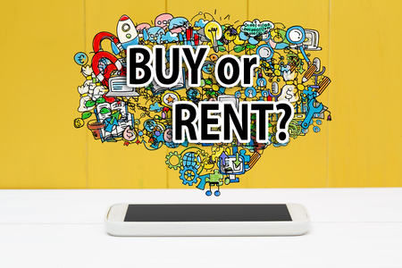 rent: Buy or Rent concept with smartphone on yellow wooden background