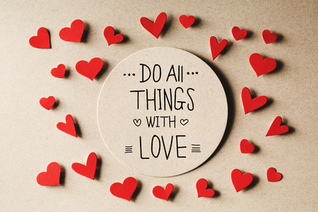 small paper: Do All Things With Love message with handmade small paper hearts Stock Photo