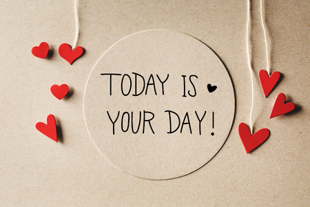 today: Today Is Your Day message with handmade small paper hearts Stock Photo