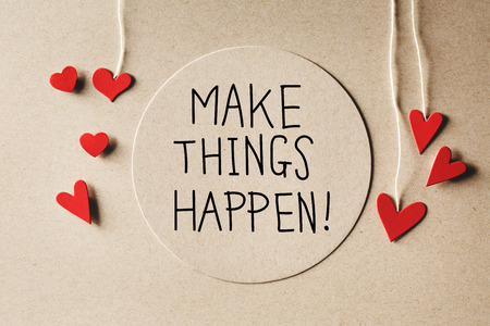 Make Things Happen message with handmade small paper hearts Фото со стока