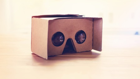 ar: Virtual reality cardboard headset on a table in natural light Stock Photo