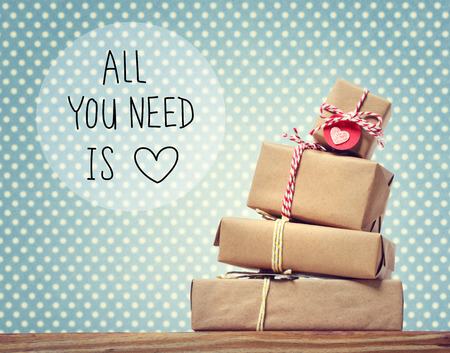 wall paper: All You Need Is Love message with stack of gift boxes