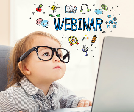 mixed race children: Webinar concept with toddler girl using her laptop