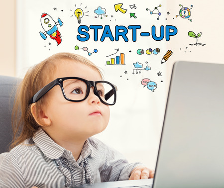 mixed race children: Startup concept with toddler girl using her laptop
