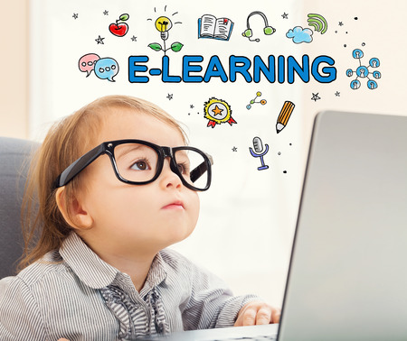 mixed race children: E-Learning concept with toddler girl using her laptop Stock Photo