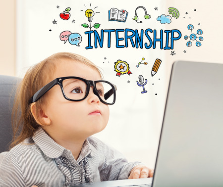 mixed race children: Internship concept with toddler girl using her laptop