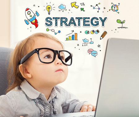 mixed race children: Strategy concept with toddler girl using her laptop