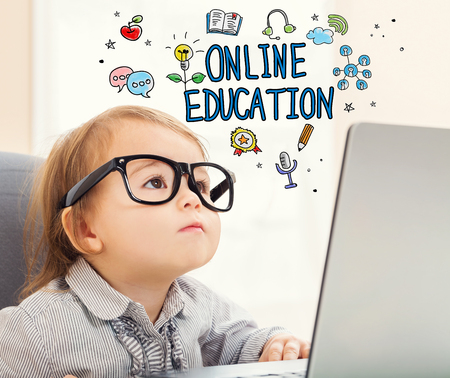 girl laptop: Online Education concept with toddler girl using her laptop