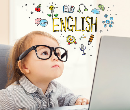 mixed race children: English concept with toddler girl using her laptop Stock Photo