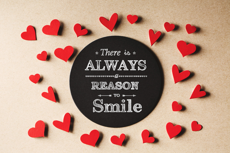 There is Always Reason to Smile message with handmade small paper hearts