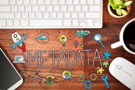 metadata: Metadata concept with workstation on a wooden desk