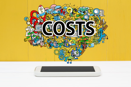 costs: Costs concept with smartphone on yellow wooden background Stock Photo